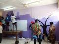 Participants helping to paint Echoing Hills School